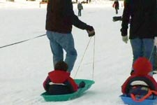 Kids being pulled on sleds