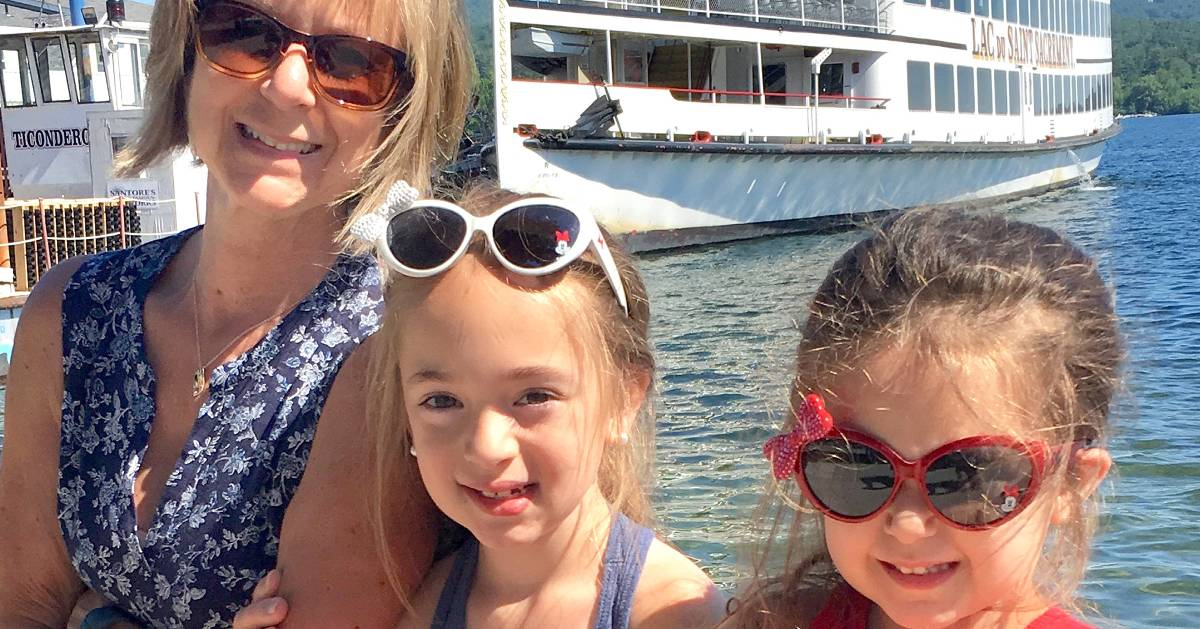 woman with two girls in front of crusie ship