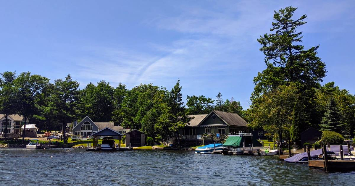 view from lake of houses with boats docked