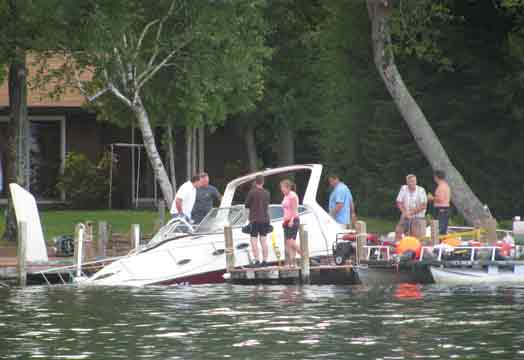 Sunken Boat Being Lifted From Water