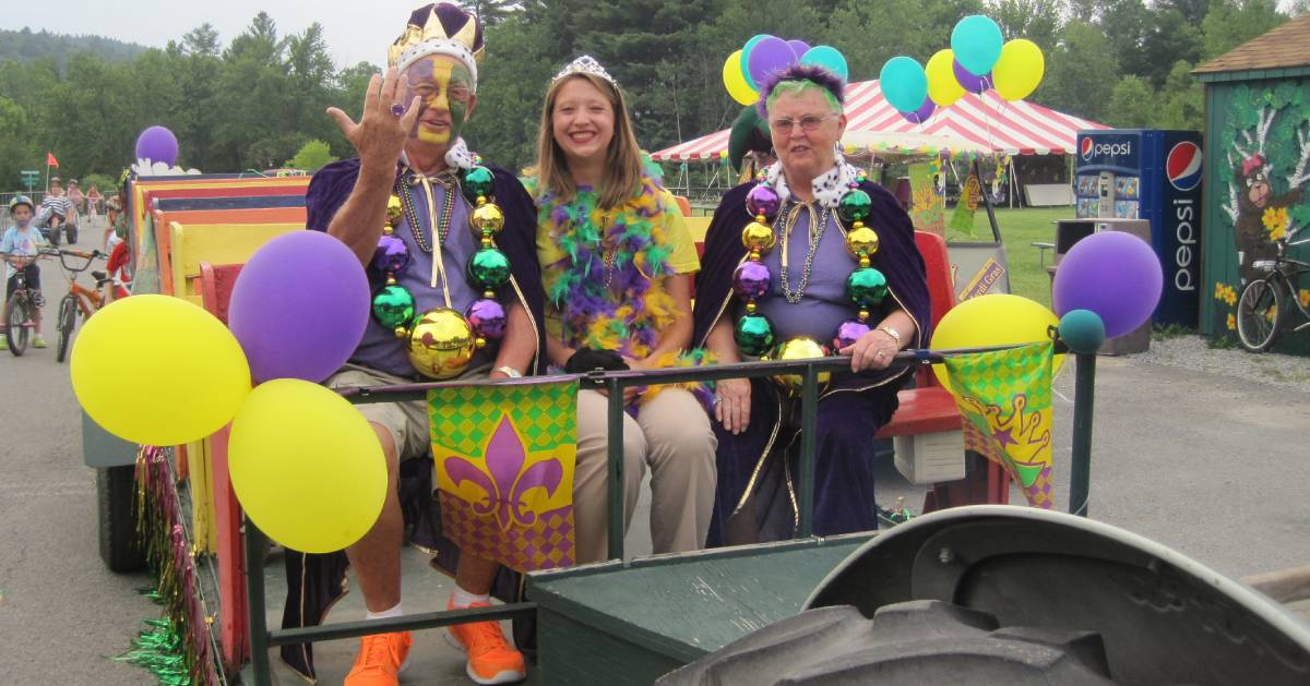 small group of people riding in a mardi gras parade
