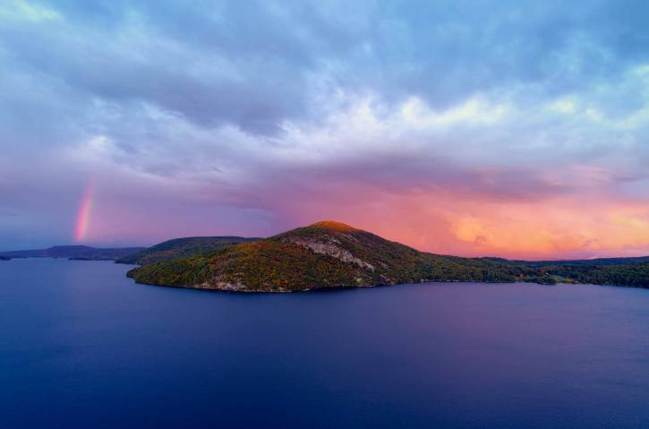 Pink and blue sunset over mountain and lake