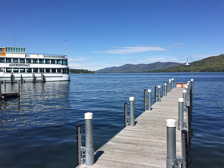 dock and steamboat on lake george on a sunny day