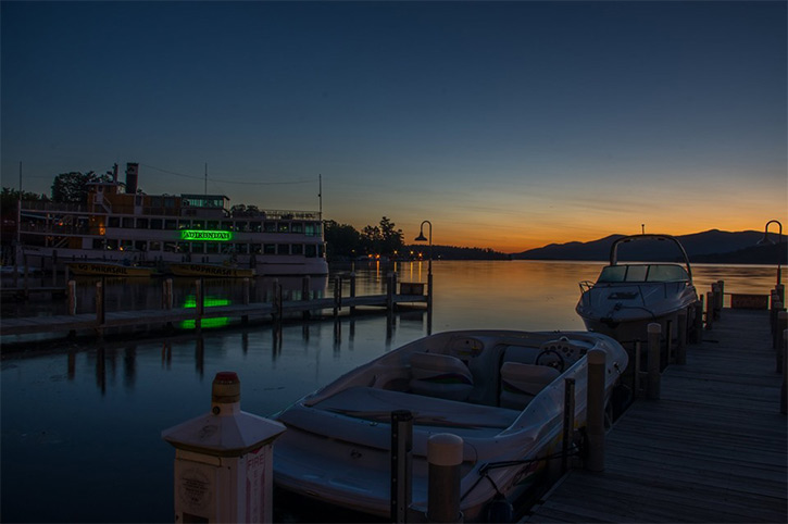 sunrise on lake george with boats in the front