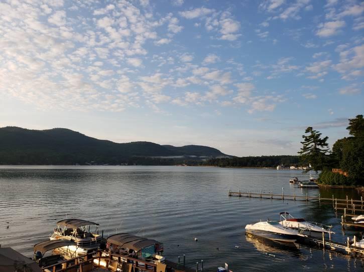 boats docked on lake at dusk