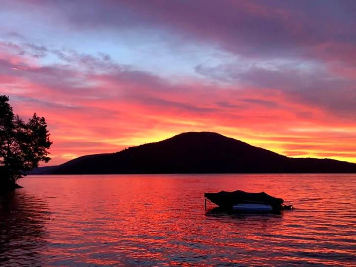 colorful sunrise over lake with mountain