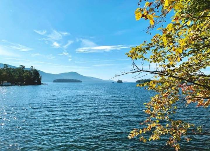 Fall leaves with background lake and mountains