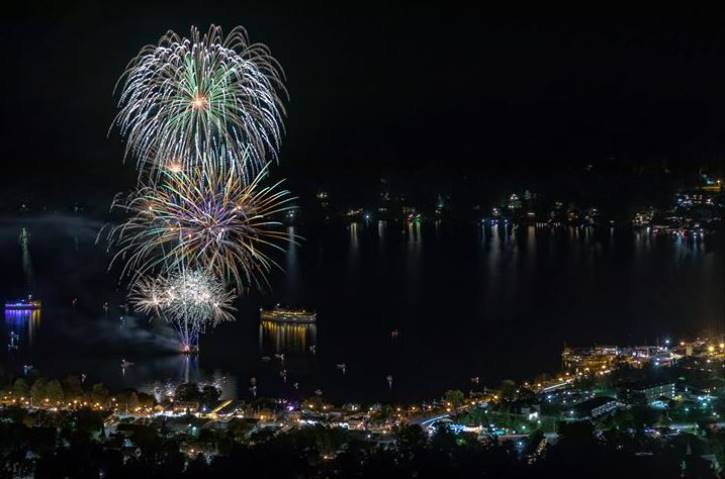fireworks at night over lake