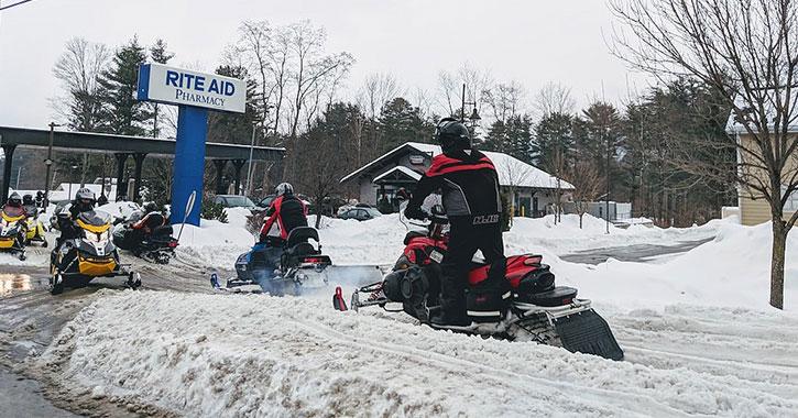 line of snowmobilers