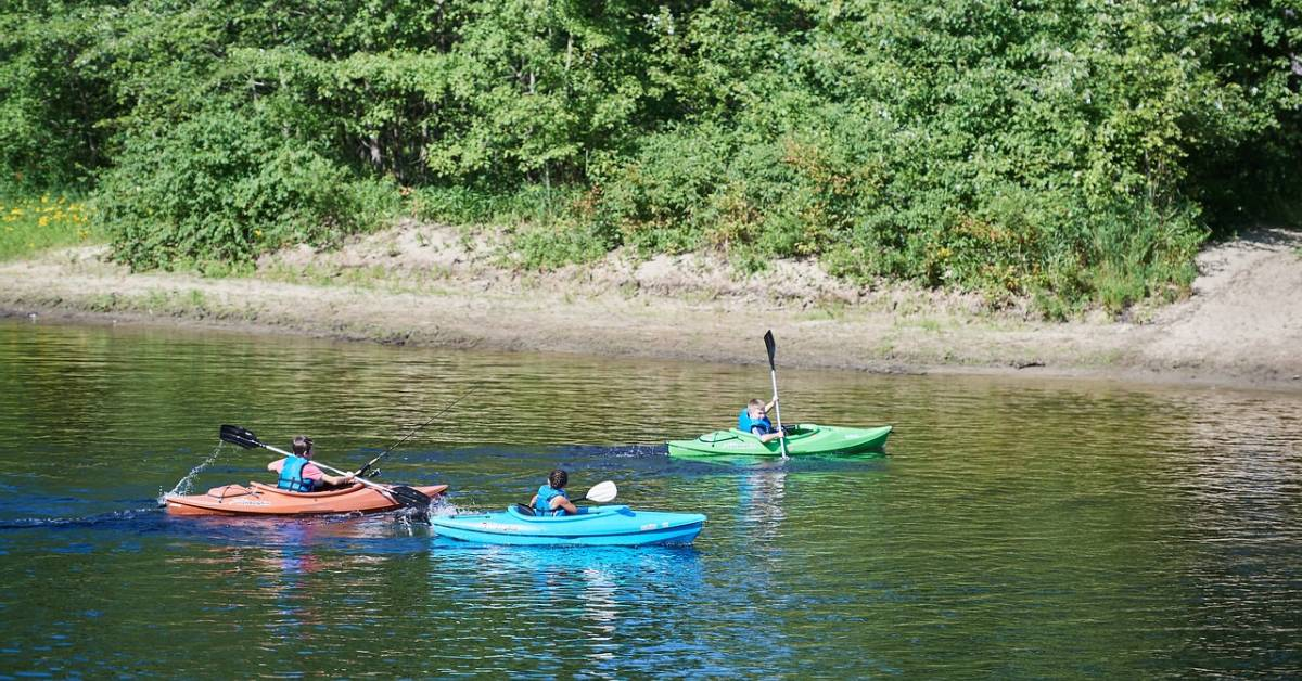 three people kayaking on a river