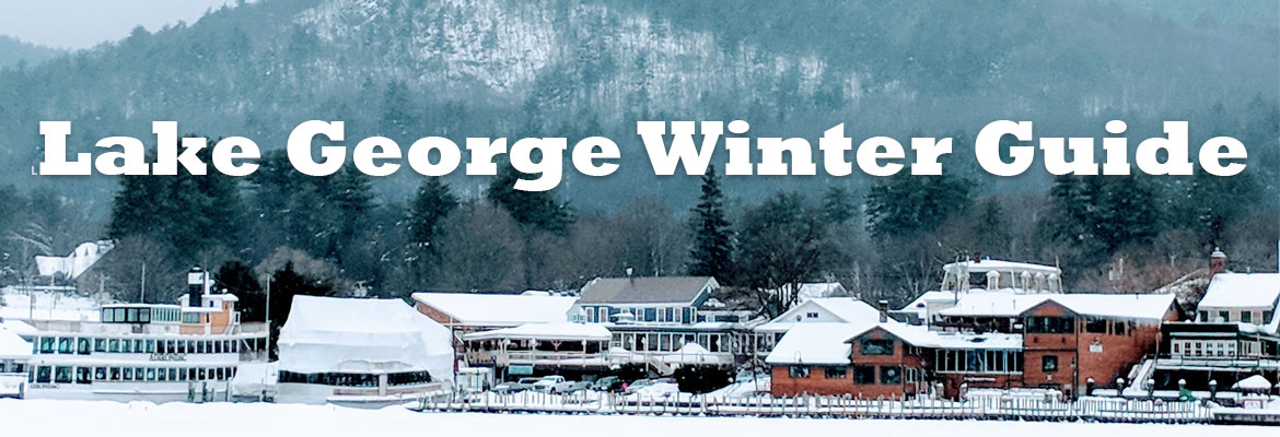winter scene in Lake George with houses and steamboat, text saying Lake George Winter Guide