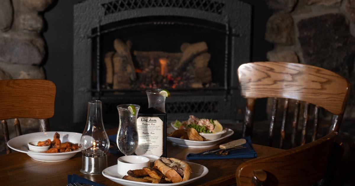 dinner table by a fireplace in a restaurant