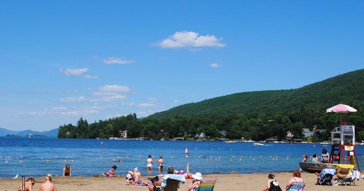 people on million dollar beach in lake george