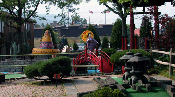 part of mini golf course with a Japanese theme and Mexican theme shown