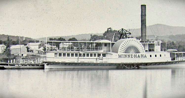 black and white photo of the first minne ha ha on the water