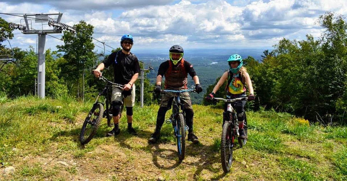 three mountain bikers