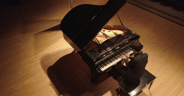 view looking down at a person playing piano