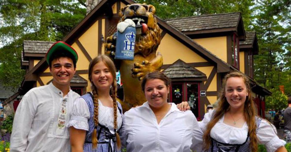four people posing at Oktoberfest