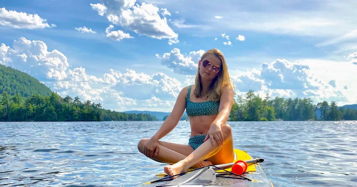girl sitting on a paddleboard