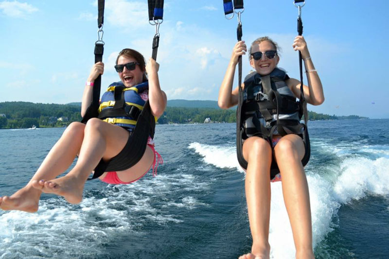 2 girls parasailing on lake george