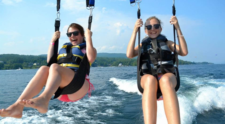 two young girls parasailing