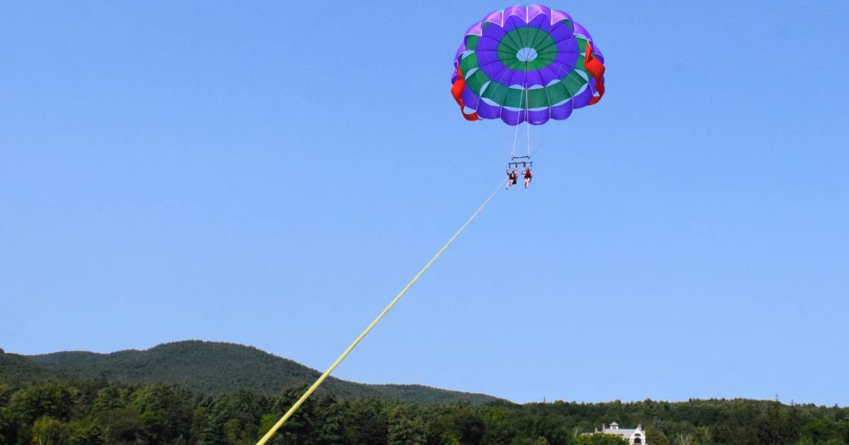 parasailers over water