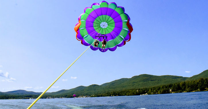 a couple parasailing over the lake