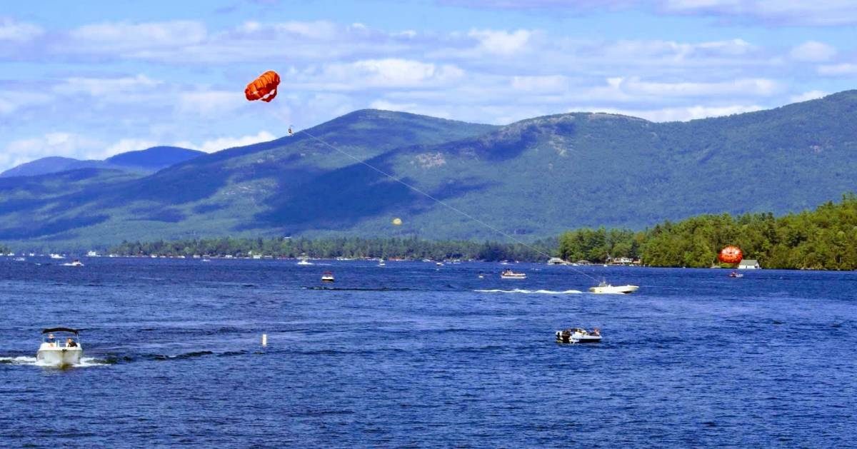 boat towing a parasail on lake george