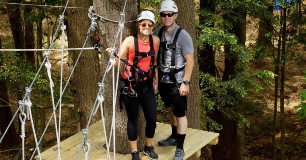 couple in treetop course