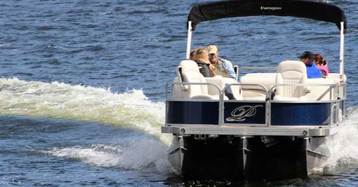 people riding in a pontoon