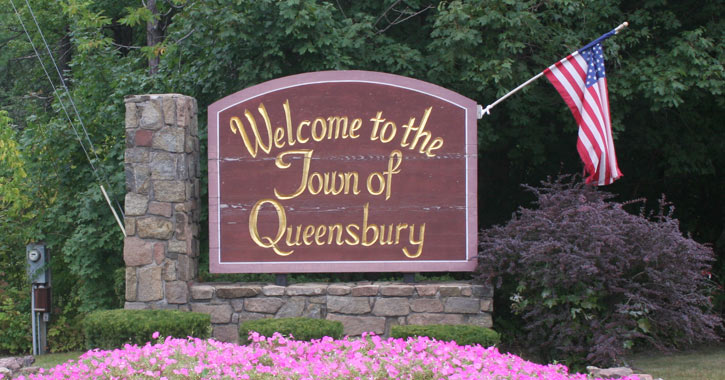 sign that says welcome to the town of queensbury