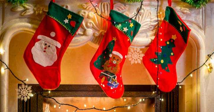 three red Christmas stockings hanging up