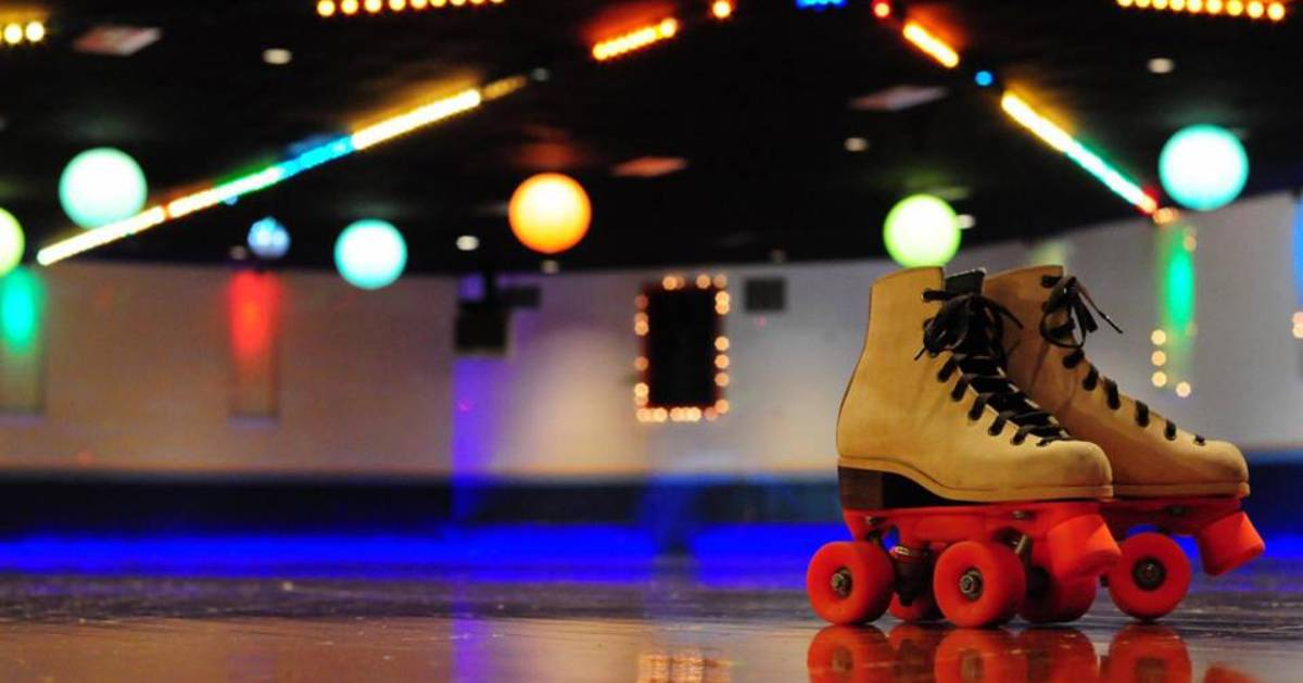 pair of roller skates on arena floor