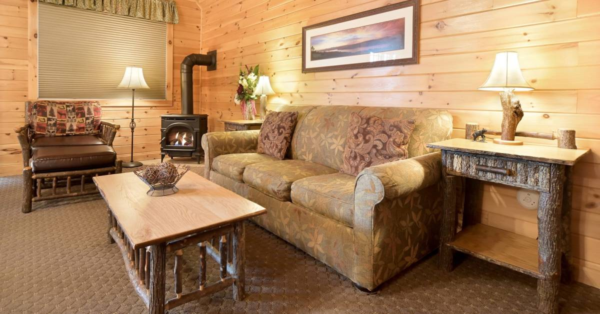 rustic living room with couch and fireplace