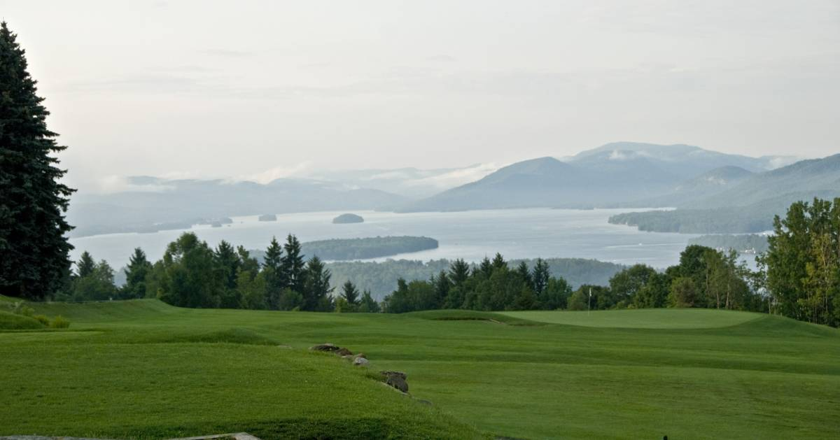 golf course and views of a lake and mountains