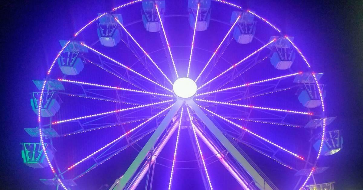 purple ferris wheel at night
