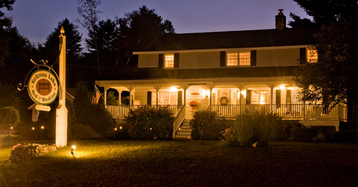 the bed and breakfast all lit up at night