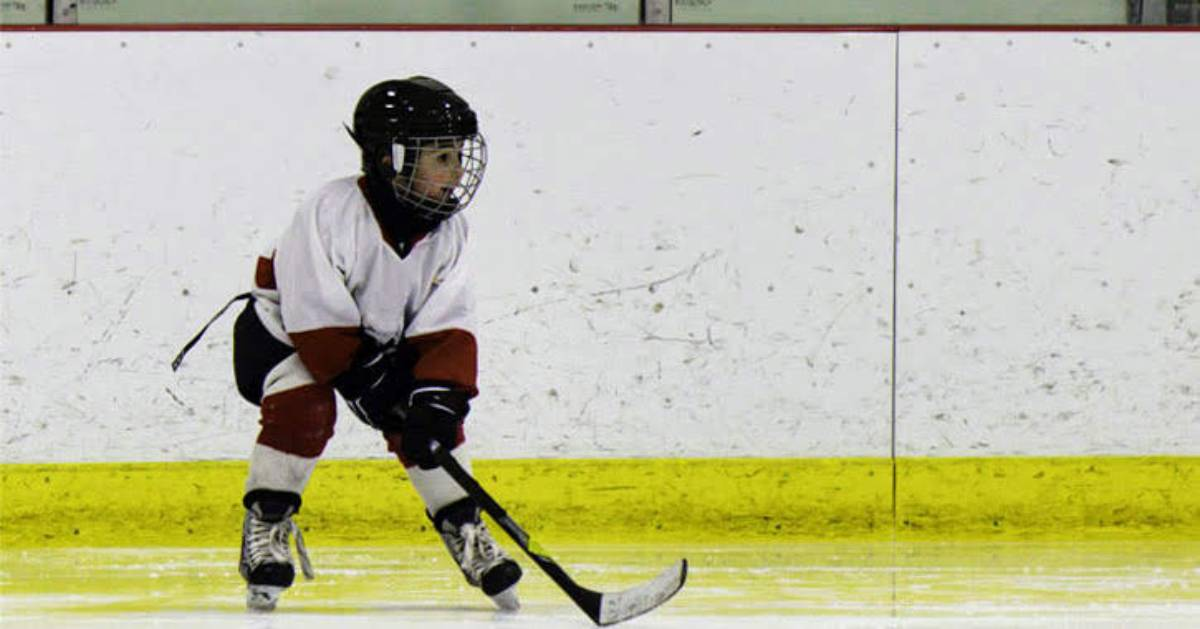boy in hockey gear