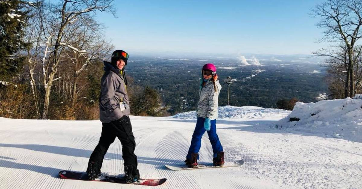 teenage boy and girl on snowboards