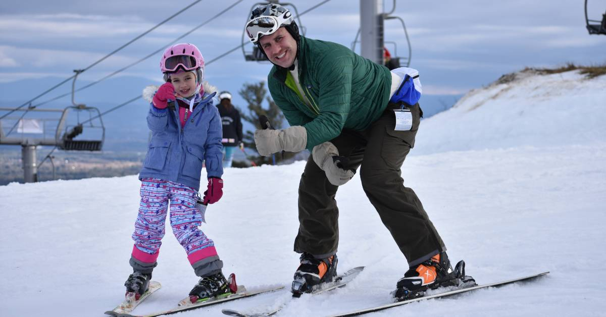 father and daughter on skis