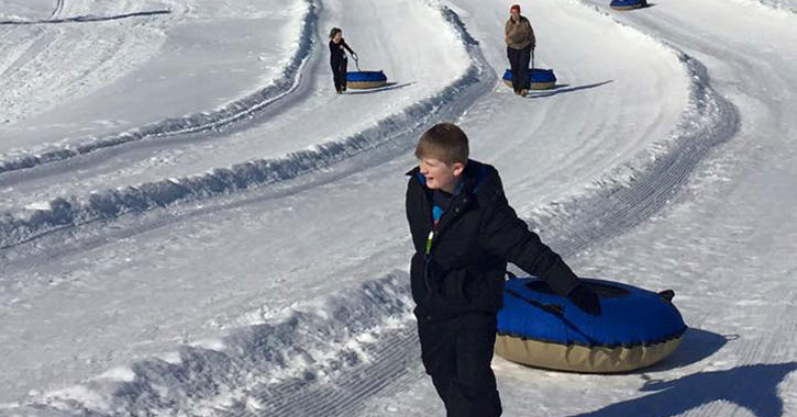 dragging a snow tube on the slope