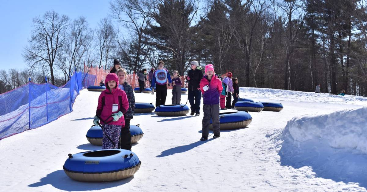 people standing in line for snow tubing