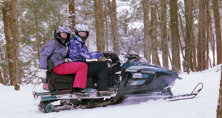 snowmobiling in snow