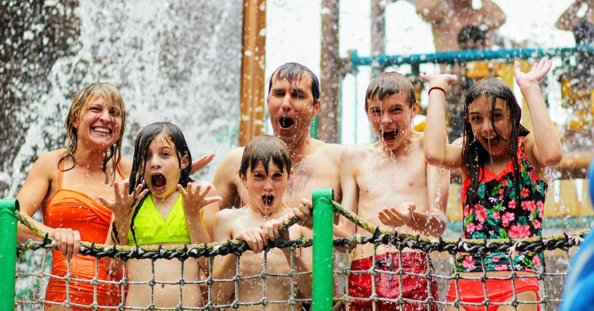 family getting splashed at waterpark