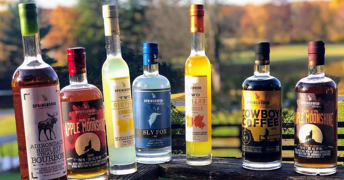 liquor bottles on fence