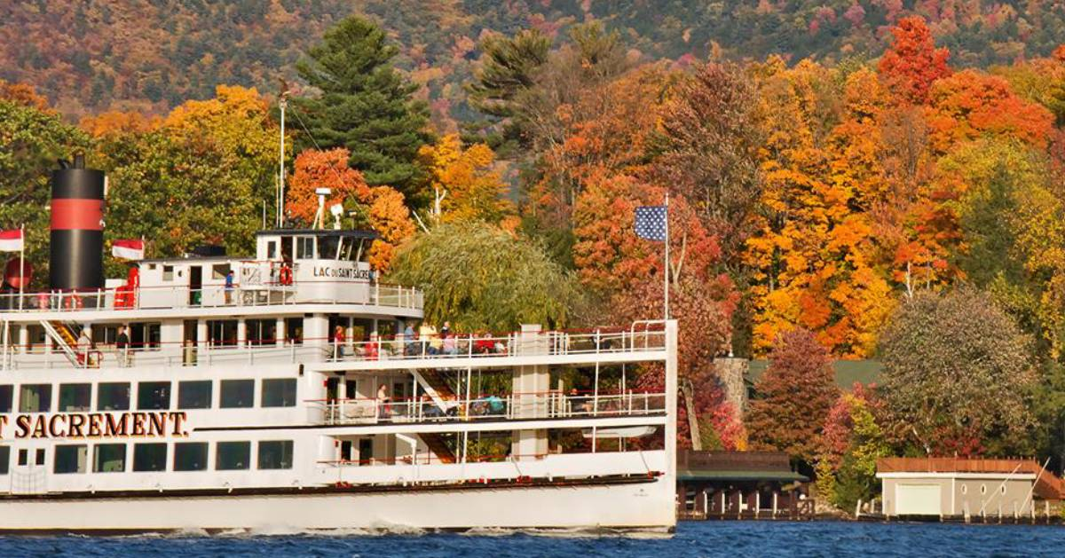 steamboat on the lake with fall foliage in the background