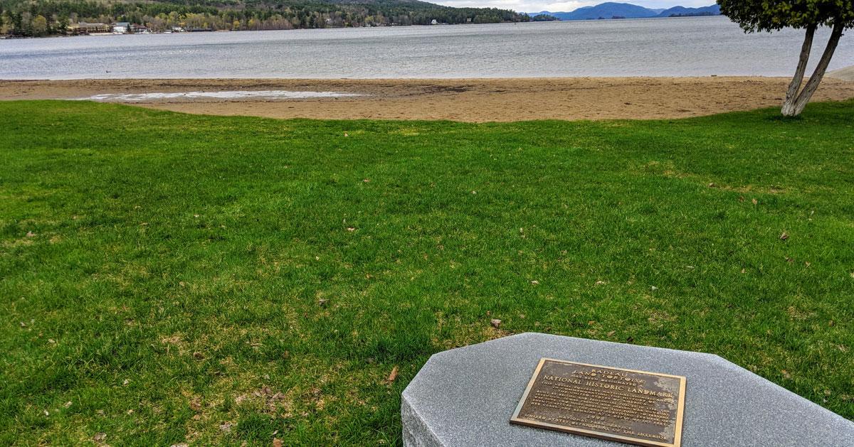 a stone monument by beach