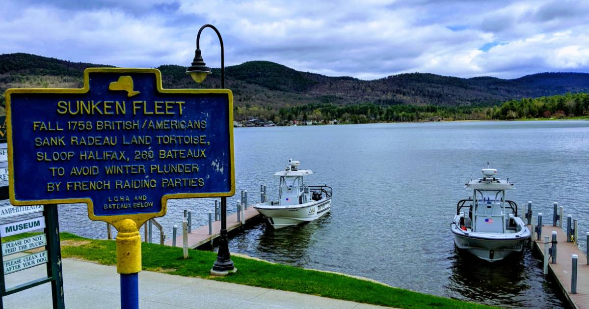 Sunken Fleet historical sign near boats in the water