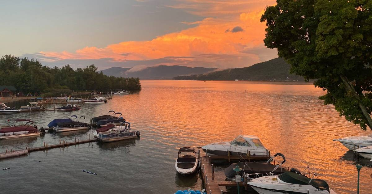 orange sunlight on clouds during sunset over a lake