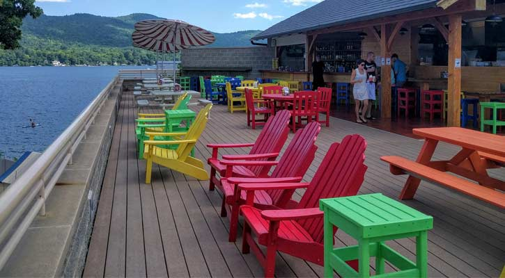 colorful deck chairs with lakeside view